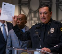 Authorities announce Houston officer case review, FBI probe