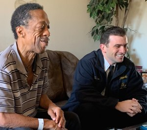 Lt. Ben Thompson (right) sits with a former C.A.R.E.S. patient and current friend of the program, Curtis Falconer. (Photo/C.A.R.E.S.)