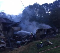 8 firefighters, 2 residents hospitalized after garage fire spreads into Pa. home