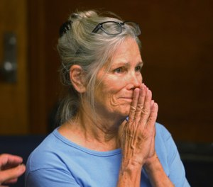 Leslie Van Houten reacts after hearing she is eligible for parole during a hearing at the California Institution for Women in Corona, Calif. (Stan Lim/Los Angeles Daily News via AP, Pool, File)