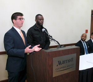 Attorney Solomon Radner, far left, and Shamieke Pugh discuss their new lawsuit against officers at an Ohio prison during a news conference with other lawyers involved on Wednesday, April 3, 2019, in Columbus, Ohio. (AP Photo/Kantele Franko)