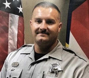 "Deputy James Eric Cook remains in stable condition ""with very serious injuries."" (Photo/Harnett County Sheriff's Office)"