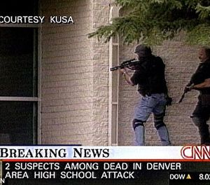 Sgt. James Smith of the Denver Police Department (left, in civilian clothes and a tactical vest and helmet) raced from his home to Columbine High, where he joined an improvised entry team to end the threat posed by the killers. Two minutes after they entered the building, the murderers shot themselves in the library. (Photo/CNN,KUSA)