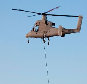 The Kaman Unmanned K-MAX multi-mission helicopter is an Unmanned Aerial Truck (UAT) based on the K-MAX heavy-lift aerial truck helicopter. (Image Kaman)