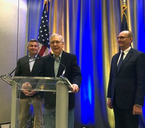 Senate Majority Leader Mitch McConnell, center, speaks to reporters on Monday, April 8, 2019, after participating in a hemp forum in Louisville, Ky. (AP Photo/Bruce Schreiner)