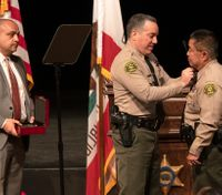 Rehired Calif. deputy ordered to turn in gun, badge over abuse claims