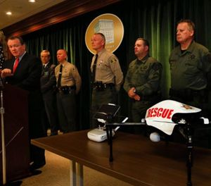 Los Angeles Sheriff Jim McDonnell, left, holds a news conference at the Hall of Justice in downtown Los Angeles to announce the recent approval from Federal Aviation Administration authorities for the use of an unmanned aircraft system, at bottom right, on Jan. 12. (Photo/Mel Melcon/Los Angeles Times/TNS)