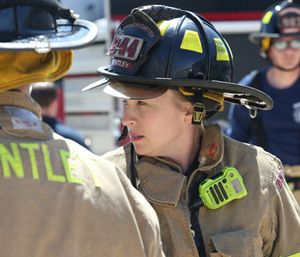 Huntley Fire Protection District firefighter/paramedic Kelly Gitzke trains with fellow fire fighters at the Huntley Fire Protection District Annex. (Photo/Antonio Perez/Chicago Tribune/TNS)
