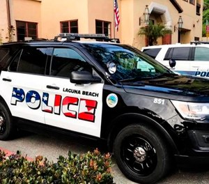 Laguna Beach Police Department shows their newly decorated Police SUV patrol vehicles in Laguna Beach, Calif.  (Laguna Beach Police Department via AP)