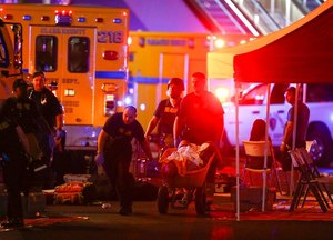 Multiple victims were being transported to hospitals after a shooting late Sunday at a music festival on the Las Vegas Strip. (Chase Stevens/Las Vegas Review-Journal via AP)