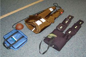 Mmilitary anti-shock trousers (left) and non-inflatable anti-shock garment (Photo courtesy Naval Submarine Medical Research Laboratory)