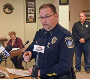 Mandan Police Chief Jason Ziegler announces an arrest in a quadruple homicide at a press conference Thursday night, April 4, 2019, in Mandan, N.D. (Tom Stromme/The Bismarck Tribune via AP)