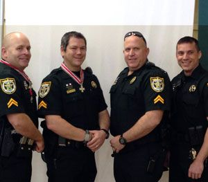 Pictured above, from left to right: Investigator Steve Hough, Investigator Todd Watkins, Investigator. John Merchant, and Investigator Jeff McGill. (PoliceOne Image)