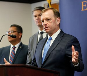 McGregor Scott, the United States Attorney for the Eastern District of California, answers questions concerning the charges against leaders of the white supremacist prison gang, the Aryan Brotherhood, during a news conference in Sacramento (AP Photo/Rich Pedroncelli, File)