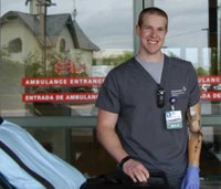 Double amputee defies odds, becomes paramedic