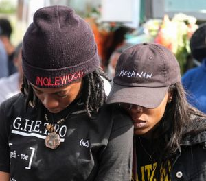 Fans of rapper Nipsey Hussle gathered at a makeshift memorial after the rapper was killed in a shooting outside his clothing store. (AP Photo/Ringo H.W. Chiu)