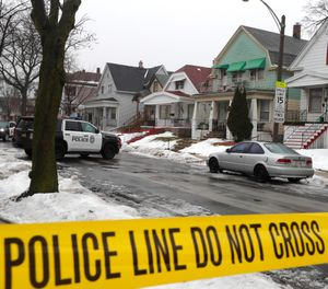 Milwaukee Police cars are stationed in a neighborhood where Milwaukee Police Officer Matthew Rittner was killed in Milwaukee on Thursday, Feb. 7, 2019. (Rick Wood/Milwaukee Journal-Sentinel via AP)