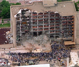 In this May 5, 1995 file photo, a large group of search and rescue crew attends a memorial service in front of the Alfred P. Murrah Federal Building in Oklahoma City.(AP Photo/Bill Waugh, Flle)
