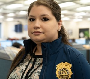 Rebecca Shutt, who works in the New York Police Department's Office of Crime Control Strategies, poses for a photo in New York (AP Photo/Mark Lennihan)