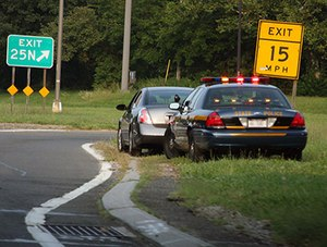 License plate readers alert officers when approaching a vehicle in which a dangerous suspect is likely present. (image Flickr/dwightsghost)