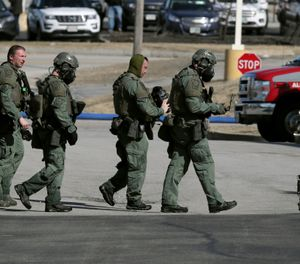 Emergency medical technicians carry a person on a stretcher into an ambulance outside the Quality Inn on Thursday, March 28, 2019, in Manchester, N.H. (AP Photo/Charles Krupa)