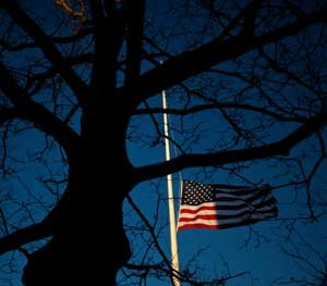 In memory of the victims at Sandy Hook, the flag is half-staff. (AP Photo/Seth Wenig)