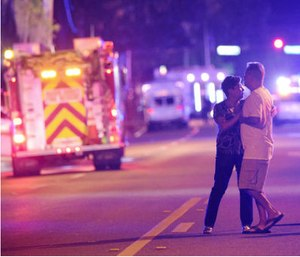 Family members wait for word from police after arriving down the street from a shooting involving multiple fatalities at Pulse Orlando nightclub. (AP Photo/Phelan M. Ebenhack)
