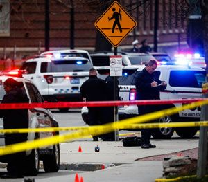 Investigators collect evidence from the pavement as police respond to an attack on campus at Ohio State University. (AP Image)