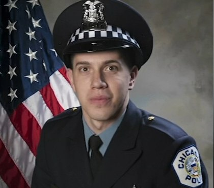 Chief: Man charged in off-duty Chicago cop's death sought a Hispanic