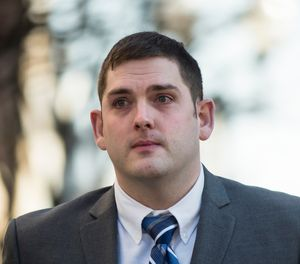 East Pittsburgh police officer Michael Rosfeld, charged with homicide in the shooting death of Antwon Rose II, walks to the Dauphin County Courthouse in Harrisburg, Pa. On the fourth day of trial in Pittsburgh, Rosfeld was acquitted Friday March 22, 2019 of all counts in the death of Rose. (AP Photo/Matt Rourke)