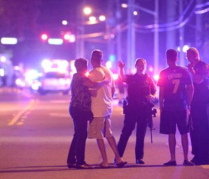 A gunman killed 49 people and injured dozes more at an Orlando nightclub on Sunday. (AP Photo/Phelan M. Ebenhack)