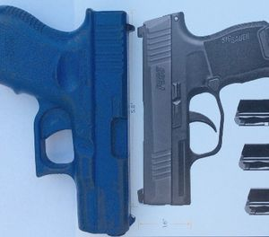 The P365 offers an overall length that is substantially shorter than other pistols in this category. A Glock 26 replica is shown for comparison. (Photo/Mike Wood)
