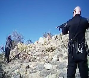 Homeless camper James Boyd, 38, left, is shown during a standoff with officers in the Sandia foothills in Albuquerque, N.M., before police fatally shot him. The shooting on March 16, 2014  generated sometimes violent protests around the city and sparked a federal investigation. (AP Images)