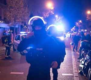 Elite police officers arrive outside the Bataclan theater in Paris, France. French President Francois Hollande saidhas closed the country's borders and declaring a state of emergency. (AP Photo)