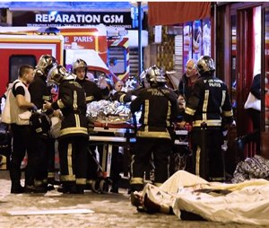 Rescue workers gather at victims in the 10th district of Paris, Friday.(AP Photo/Jacques Brinon)