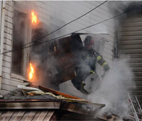 Woman charged with arson in fatal boarding house fire