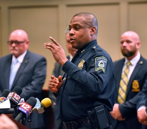 Police Chief Marlos Walker comments during a press conference Monday, March 18, 2019 announcing the arrest of Coley McCraney of nearby Dothan for the 1999 slayings of Dothan teens J.B. Beasley and Tracie Hawlett. McCraney was arrested Friday and is held in the Dale County Jail with no bond. (Jay Hare/Dothan Eagle via AP)