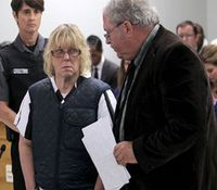 Prison worker charged with aiding escapees appears in court