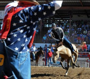 Inmates participating in the rodeo all wear helmets, protective vests and a mouth piece. (Photo/Lousiana State Penitentiary)
