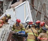 SD firefighter held hand of woman buried under building