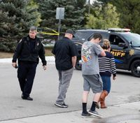 Two students kill classmate, wound 8 others in Colo. school shooting