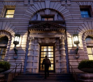 A man walks up the steps of the 9th U.S. Circuit Court of Appeals building in San Francisco. (AP Photo/Marcio Jose Sanchez, File)
