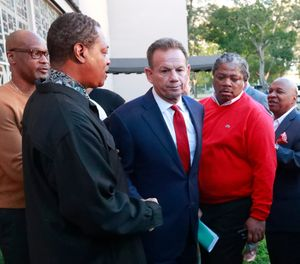 Suspended Broward County Sheriff Scott Israel, center, leaves a news conference surrounded by supporters after new Florida Gov. Ron DeSantis suspended him, in Fort Lauderdale, Fla. (AP Photo/Wilfredo Lee)