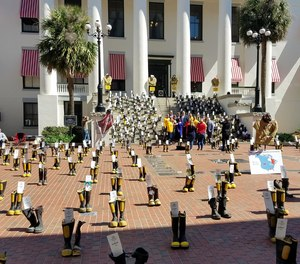 Each set of boots represented a Florida firefighter that is battling or lost a battle with cancer due to hazards in the fire industry. (Photo/Twitter)