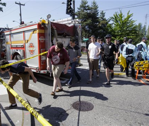Seattle Pacific University students are lead out of the crime scene area after a shooting occurred on the university's campus Thursday. (Image AP)