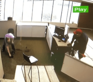 The clerk picked up the gun after the would-be robber dropped it. (Photo/Security footage)