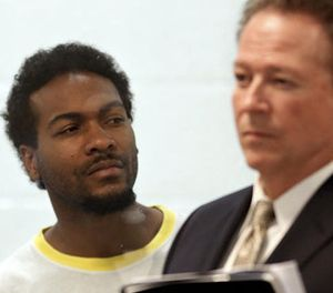 Trenton Trevon Lovell, 27, left, the suspect in the shooting death of L.A. County sheriff's deputy Steve Owen, with public defender John Henderson, during his arraignment in Lancaster. (Photo/Los Angeles Times)