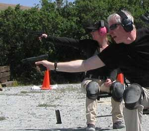 PoliceOne Editor-at-Large Doug Wyllie dumps an empty magazine and reaches to reload during a drill to simulate responding to a sudden ambush attack in a restaurant or some other place where you'd be seated.  (PoliceOne Image)
