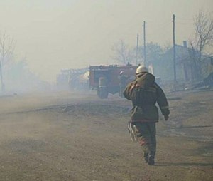In this undated photo taken from the Website of the Ministry for Emergency Situations, Khakassia branch, a firefighter extinguishes the fire in Khakassia, a region in southeastern Siberia, Russia. (Ministry for Emergency Situations, Khakassia branch in Siberia via AP)