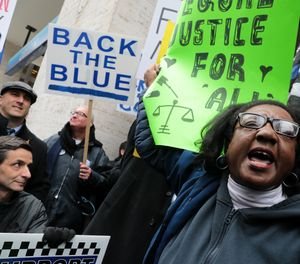 Dueling protests from the Fraternal Order of Police, left, and Chicago Alliance Against Racist and Political Repression take place April 1, 2019, outside the Cook County Administration Building in response to the ongoing controversy over the Jussie Smollett case. (Antonio Perez/Chicago Tribune/TNS)